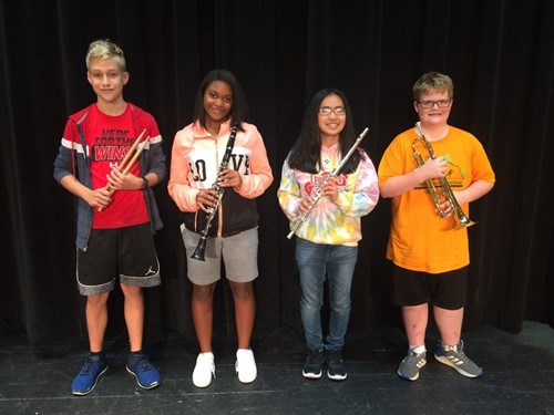 students holding instruments