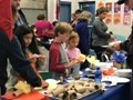 students and parents participating in an art fair