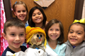 students holding scarecrow