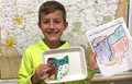 student holding salt map of ohio and worksheet