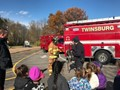 students learning about emergency transportation while standing by a firetruck