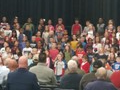 students performing songs on stage