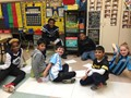 football players helping in the classroom