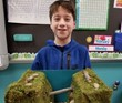 student holding science project