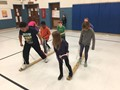 students participating in skiing in gym class