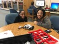 two students building a robott