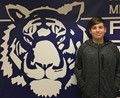 student standing next to tiger logo