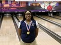 student wearing state championship medal