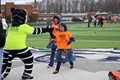 twinsburg tiger mascot giving students high five