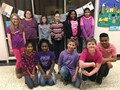 group of students wearing purple and pink