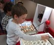 students putting eggs in incubators
