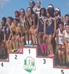 student athletes standing on podium at state track meet