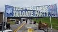 banner with words tiger wellness tailgate party