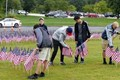 students setting up american flag display