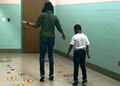 student and teacher using new sensory path