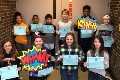 students holding certificates