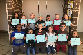 group of students holding certificates