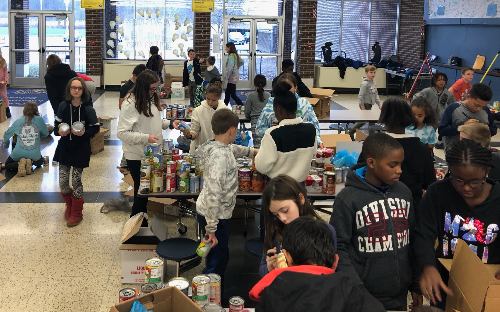 students organizing canned goods