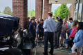 students standing around model t ford