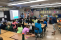 students in a classroom at desks