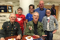 veterans and students at table