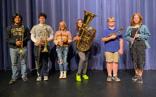students holding band instruments