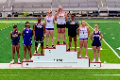 student athletes on podium with medals