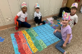 students creating a 100 day counting chart