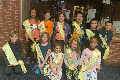 students in group photo wearing smile patrol sashes