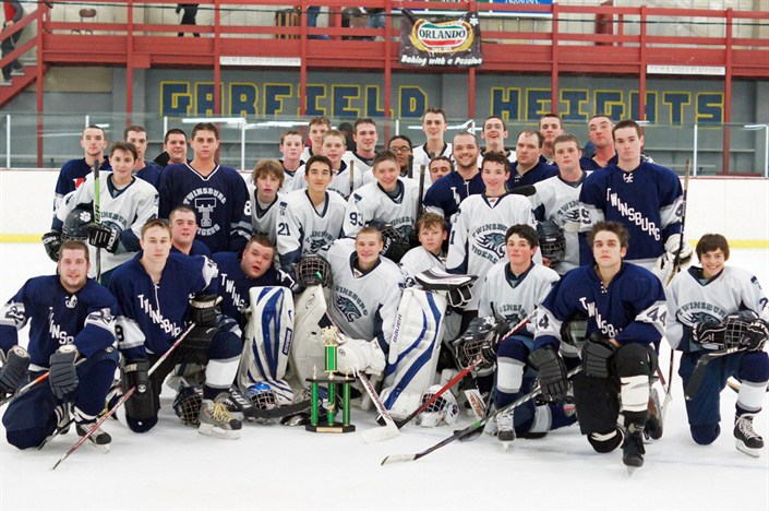 2012 Varsity team (white) pose with Alumni (blue) with trophy