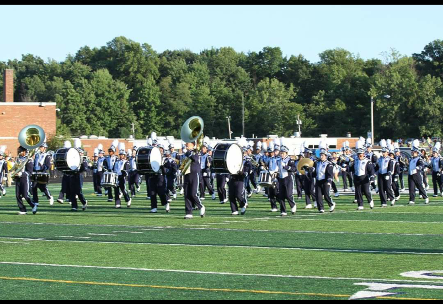 Marching band performing on the field