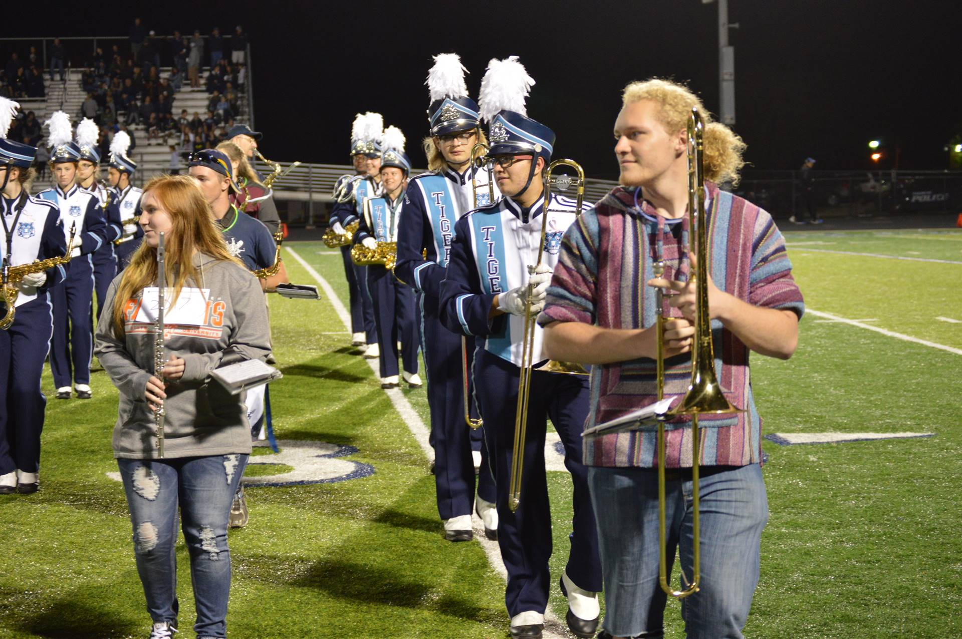 Alumni band and current band members on the field