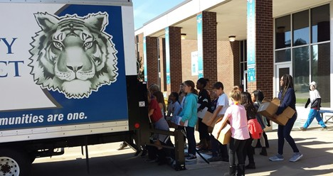 Students loading food donations on truck