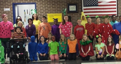 Staff and students dressed like fruit