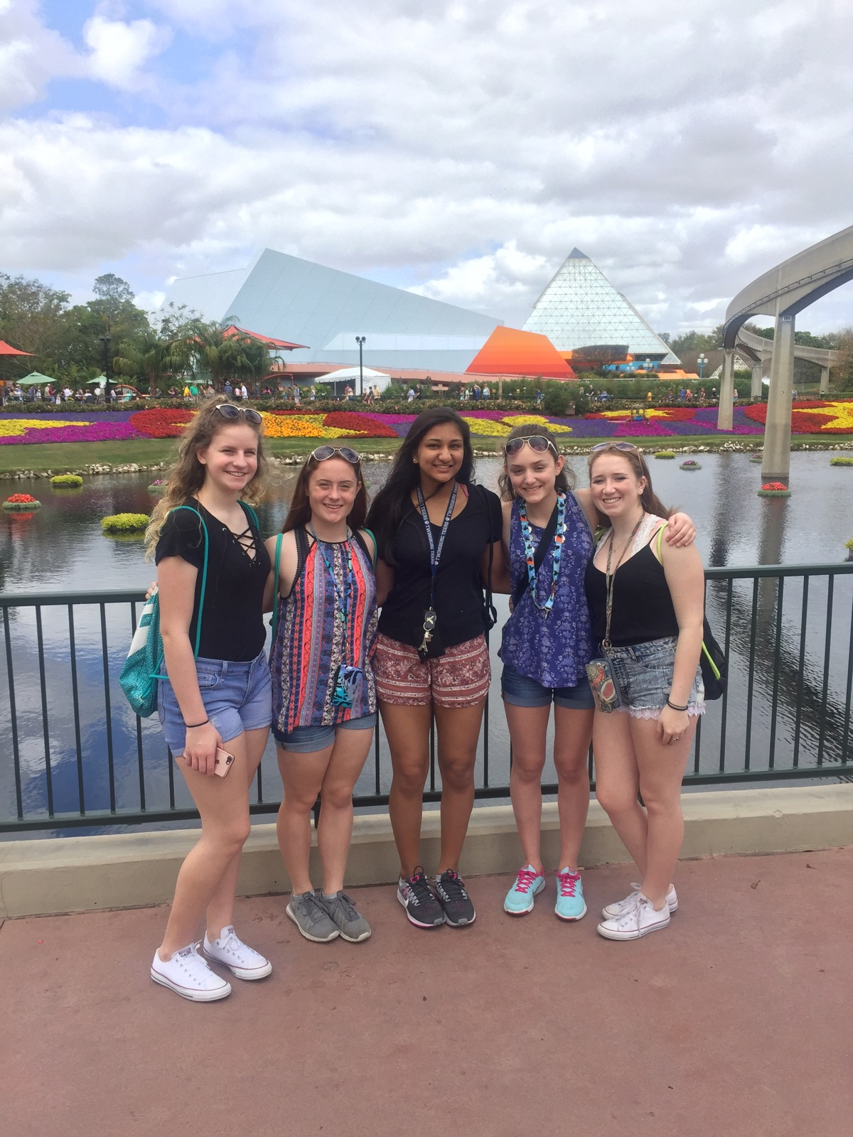 Girls standing in front of water at Disney.