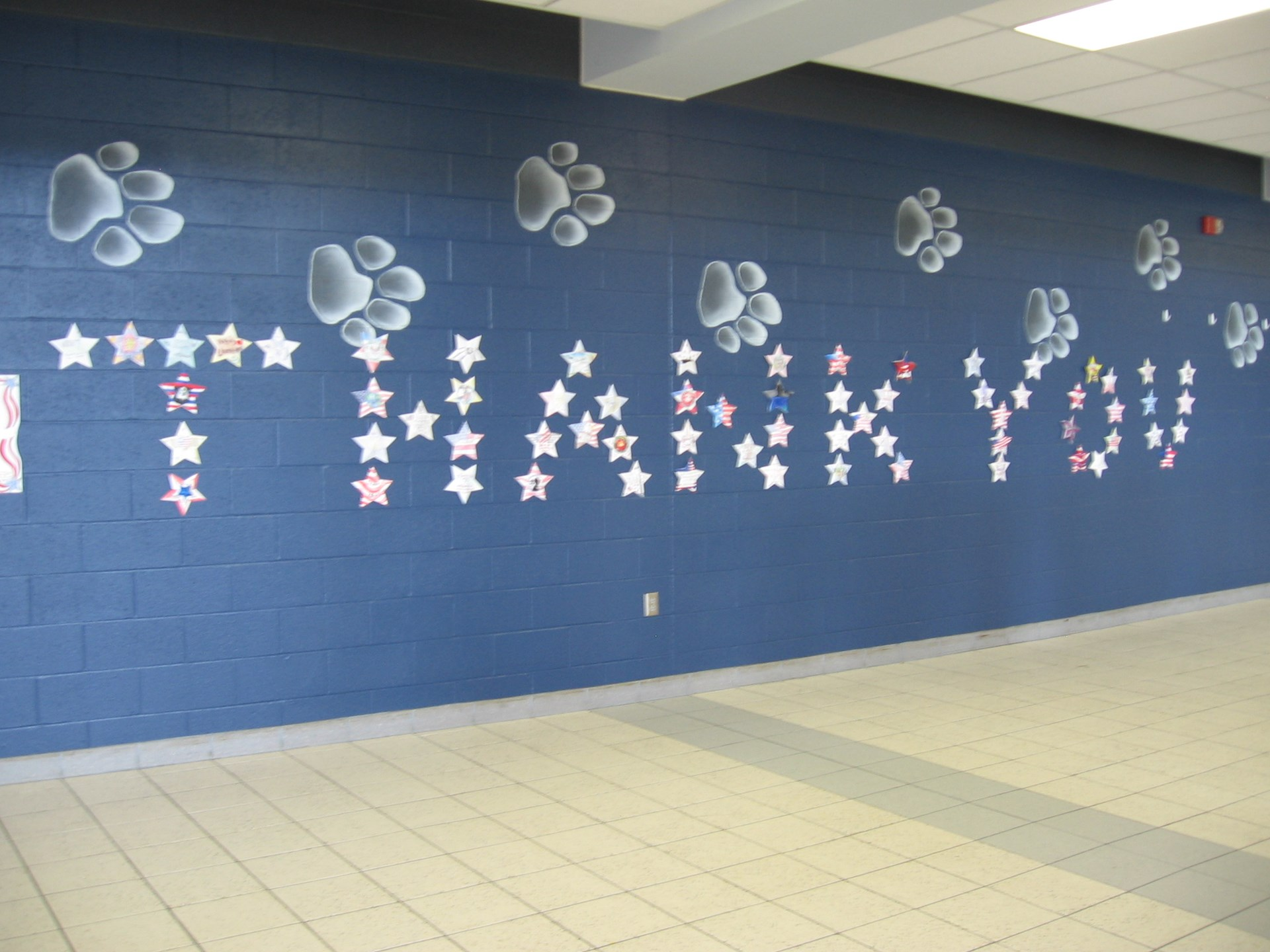 Word thank you made of stars on a wall