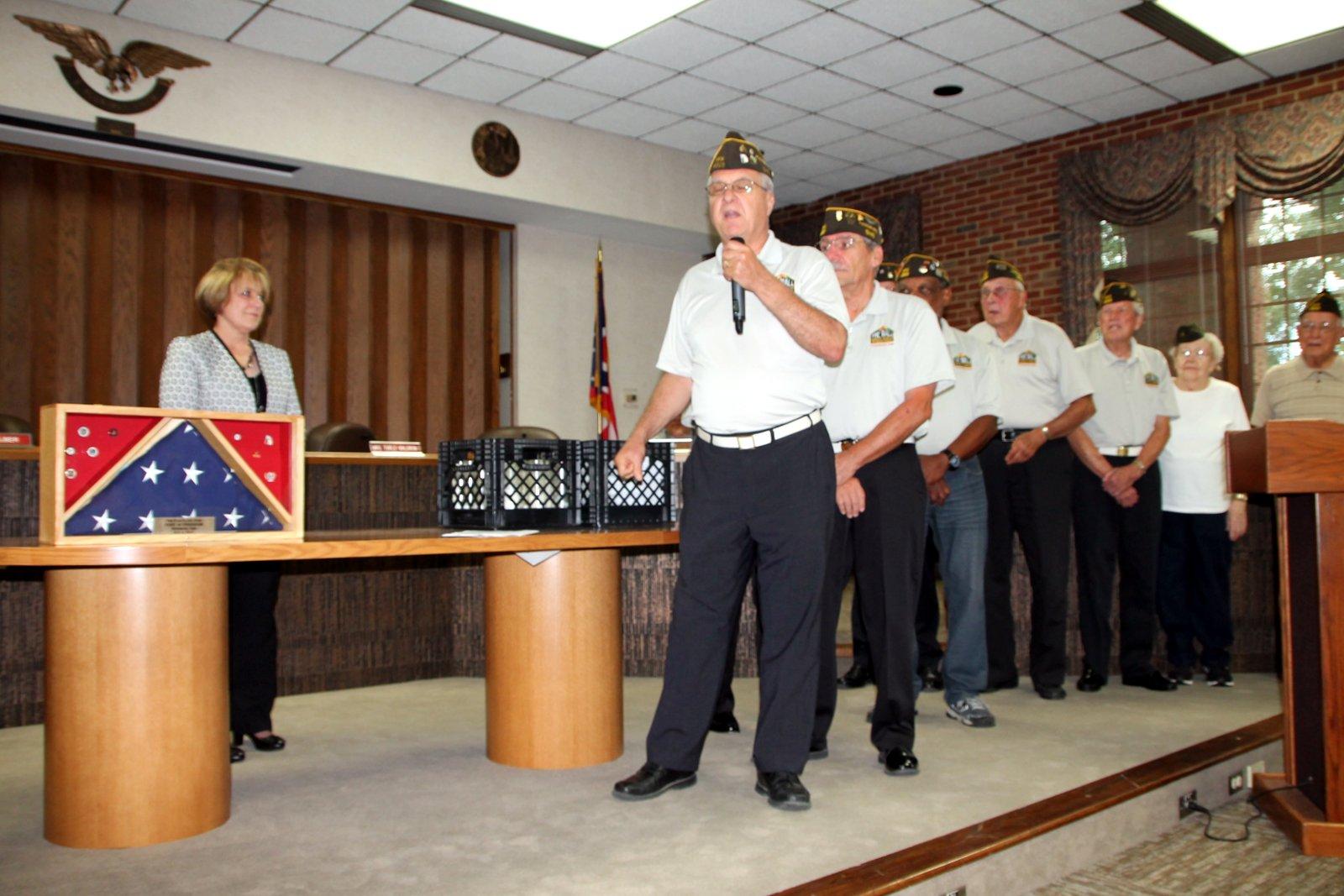 Veterans presenting American flag
