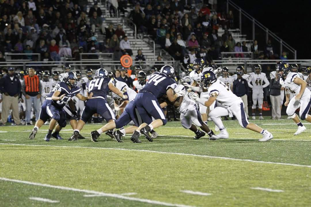 Offensive line blocking the opponent