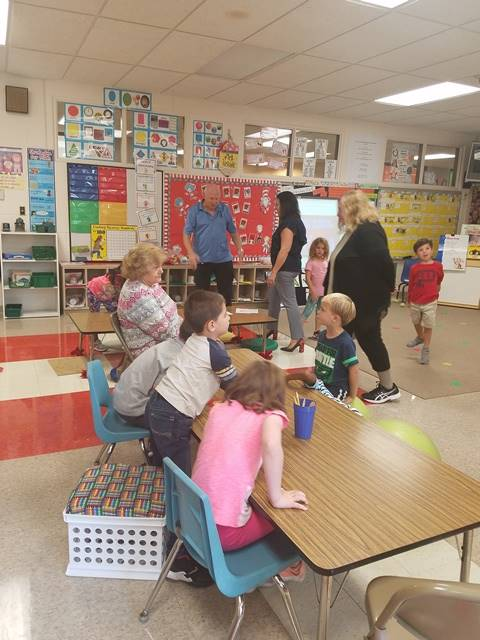 Senior citizens touring a classroom
