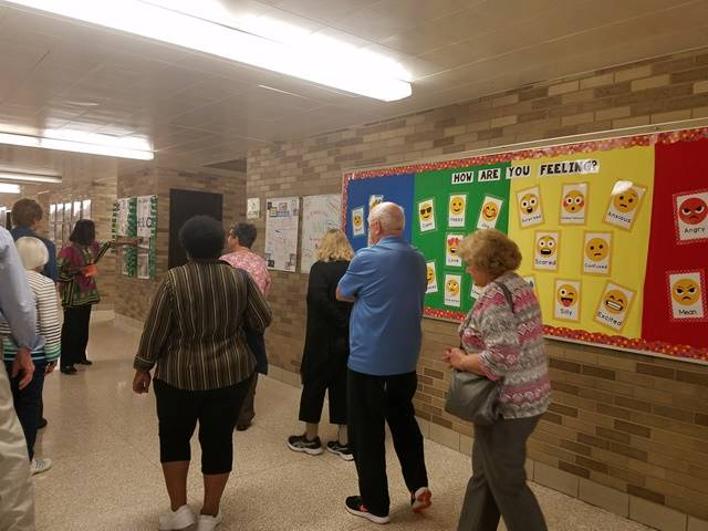 senior citizens touring a school
