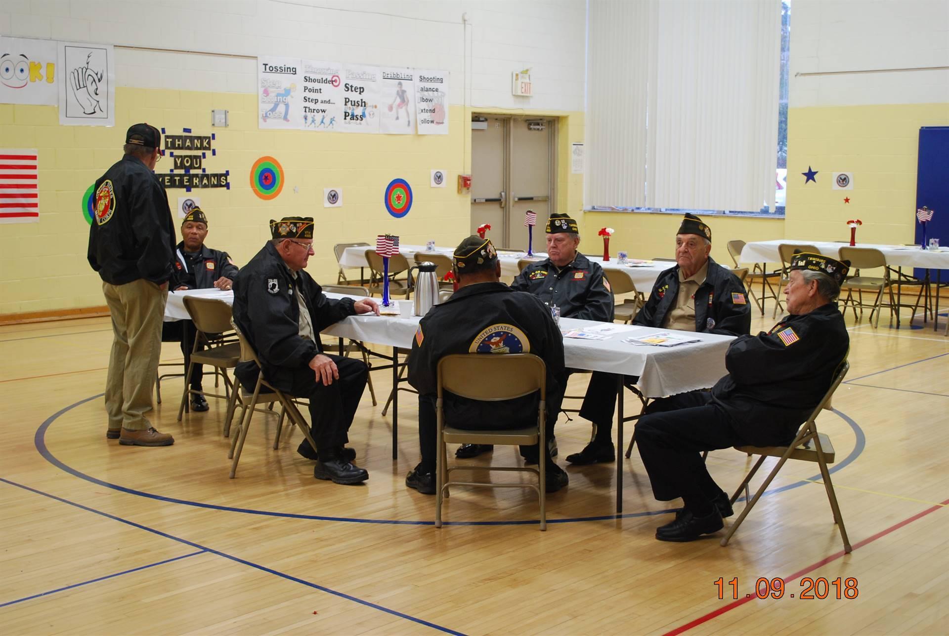 Military veterans enjoying refreshments
