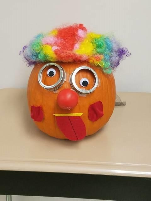Pumpkin decorated as a silly clown