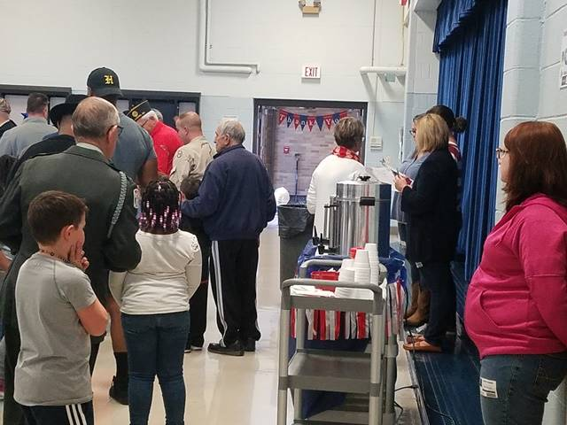 Veterans and students enjoying refreshments in cafeteria