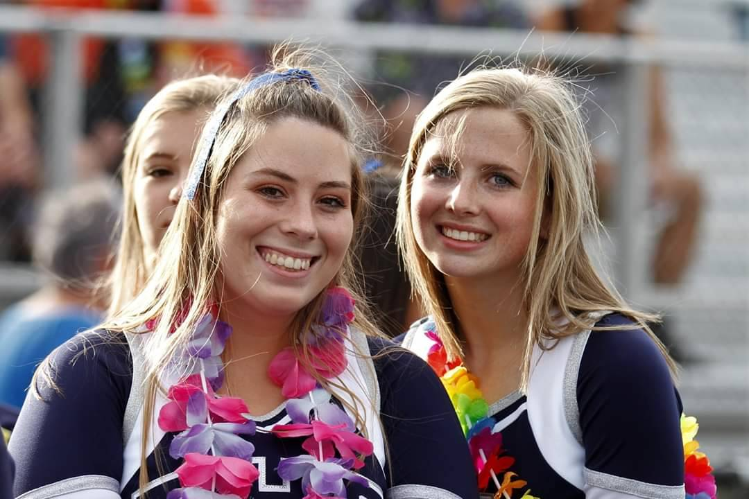 Cheerleaders posing for a picture during the game.