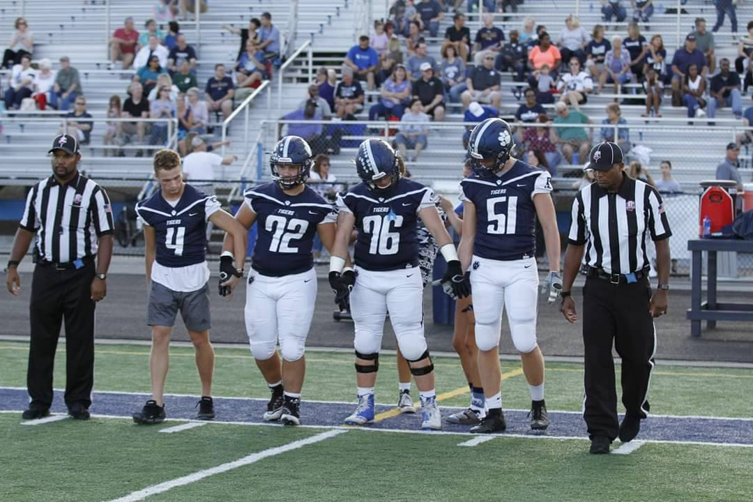 Team Captains with the game officials getting ready to walk out for the coin toss.