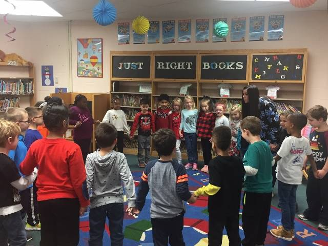 Students standing in a circle