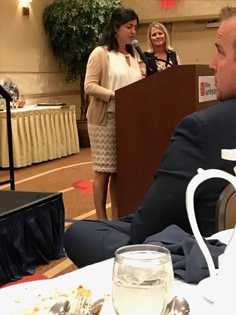 Teacher speaking at podium