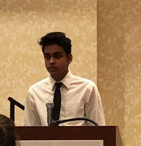 Student speaking at podium