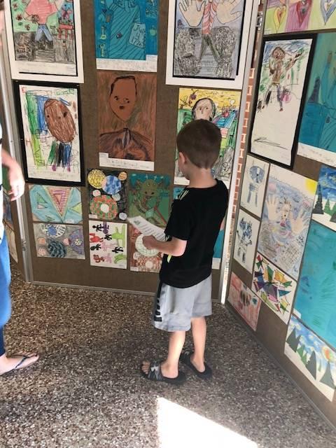 Student observing artwork display