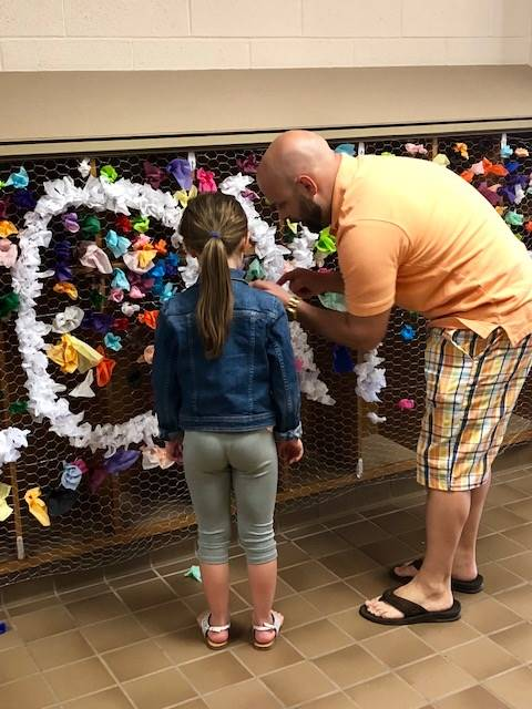 Father and daughter creating art work